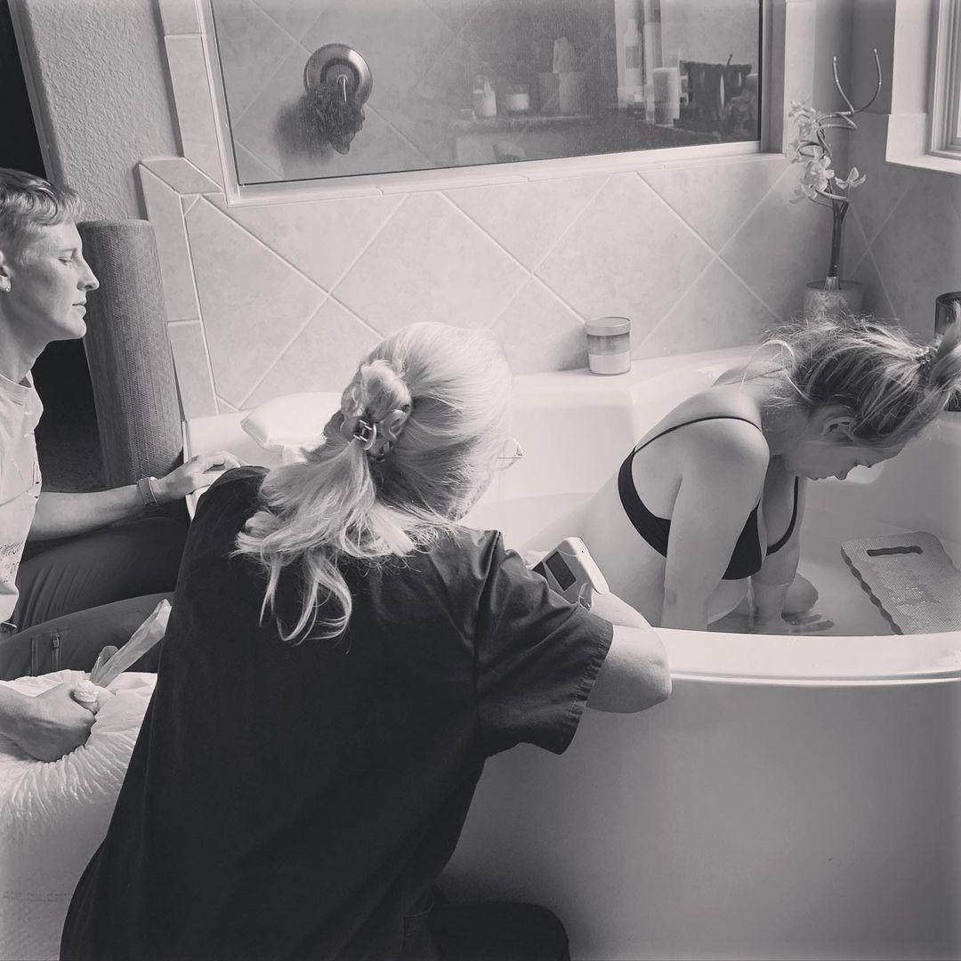 Woman HypnoBirthing in bath